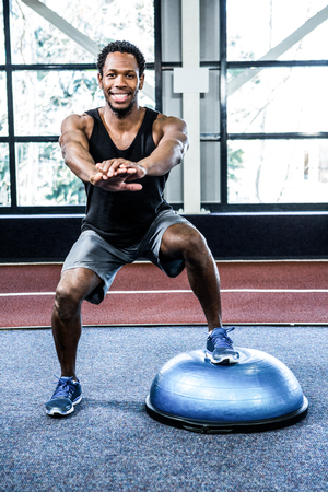 sports race: Fit man doing exercise with bosu ball in crossfit Stock Photo