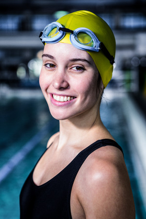 tied hair: Portrait of a woman swimmer looking the camera in swimming pool Stock Photo