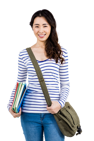 shoulder bag: Portrait of cheerful woman with shoulder bag and files against white background Stock Photo