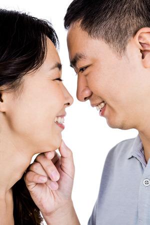 adoring: Cheerful man adoring woman against white background Stock Photo