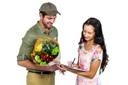 cartero: Woman signing for bouquet delivery with smiling postman on white screen