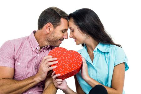 heart shaped box: Peaceful couple holding a heart shaped box on white screen