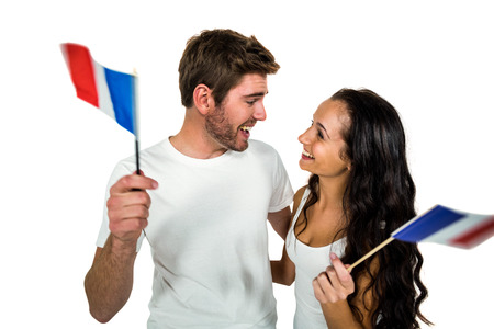 caucasian white: Happy couple holding French flag on white screen