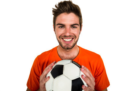 supporter: Handsome supporter holding football ball on white screen Stock Photo