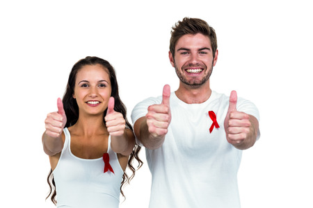 Smiling couple showing thumbs up on white background