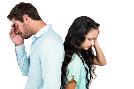 not talking: Couple back to back not talking after argument on white screen Stock Photo