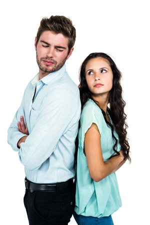 not talking: Unhappy couple back to back not talking after argument on white screen Stock Photo