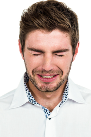 dreariness: Close-up of crying man standing on white background Stock Photo