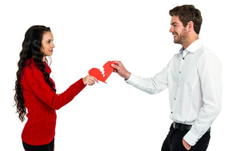 strife: couple holding red cracked heart shape on white background