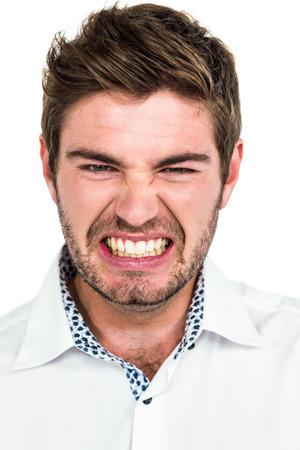 outraged: Portrait of angry man on white background