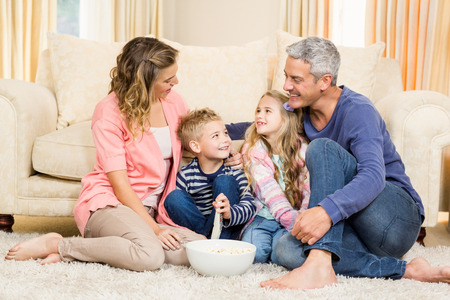 changing channel: Happy family enjoying a movie together at home