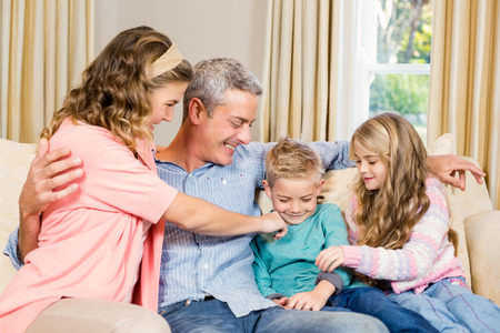 family sofa: Happy family on the sofa in living room