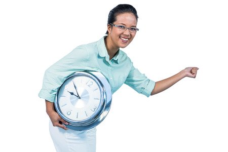 attractive charismatic: Delighted businesswoman holding a clock against white background