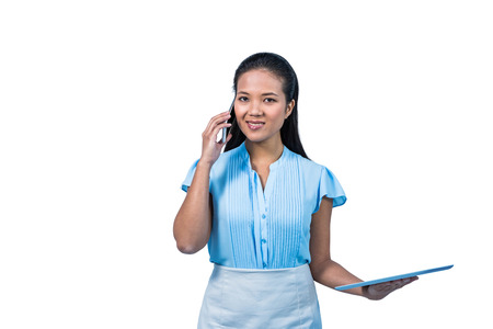 phoning: Smiling businesswoman with tablet phoning on white background