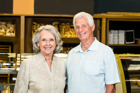 bakery store: Portrait of senior couple at the bakery store Stock Photo