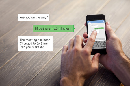 text messaging: Smartphone text messaging  against cropped image of person using smartphone
