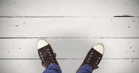 white wood floor: Man standing on hardwood floor against white wood