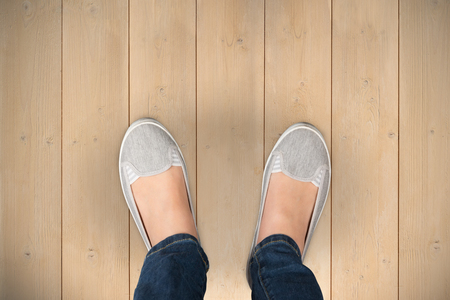 casually dressed: Casually dressed womans feet against wooden planks