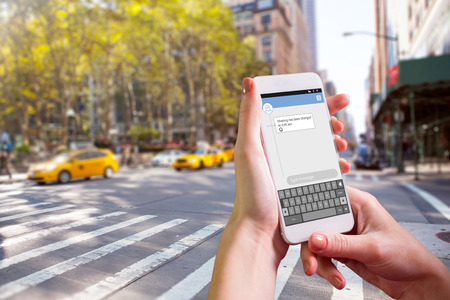 mobile sms: Hand holding smartphone against smartphone text messaging
