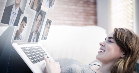 woman profile: Profile pictures against young woman using laptop Stock Photo