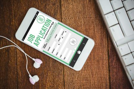 screenshot: Job application against white smartphone with white headphones