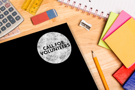 parer: Call for volunteers against students desk Stock Photo