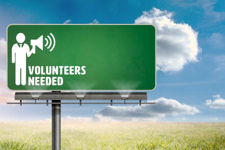 needed: Volunteers needed against sunny landscape