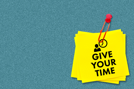 your: give your time against orange Stock Photo
