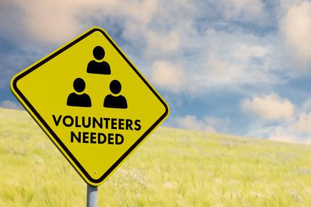 needed: Volunteers needed against nature scene Stock Photo