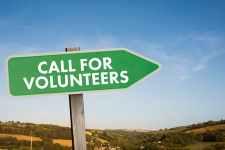 call of nature: Call for volunteers against blue sky over fields Stock Photo