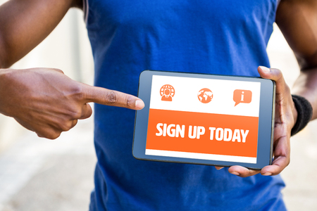 blank tablet: Orange sign up today against man pointing at blank screen of digital tablet Stock Photo