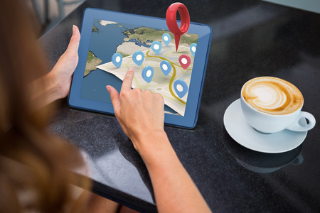 weekend activities: Close-up of navigation marker against woman having coffee and using her tablet Stock Photo