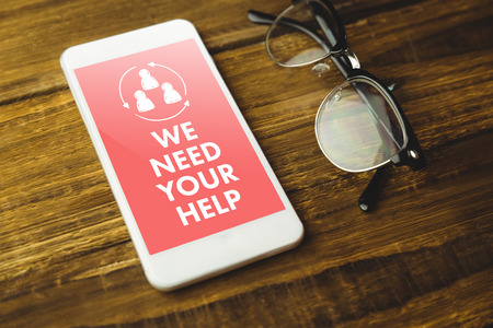 in need of space: We need your help against high angle view of cellphone and eyeglasses Stock Photo