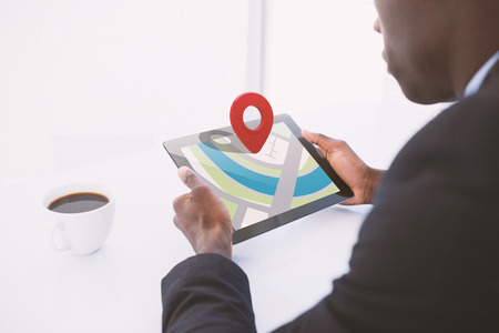 using tablet: Close-up of red map pointer against businessman using digital tablet