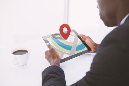 digital tablet: Close-up of red map pointer against businessman using digital tablet