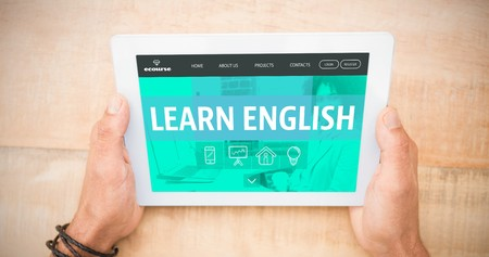 blank tablet: Learn english interface against hands holding blank screen tablet