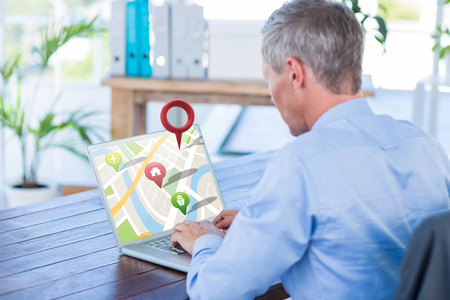 mature adult: Close-up of red map pointer against businessman working with laptop computer Stock Photo