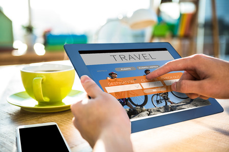 booked: Cropped image of hipster businessman using tablet  against holidays booking app