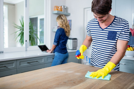 scrubbing up: Cute couple cleaning up the kitchen