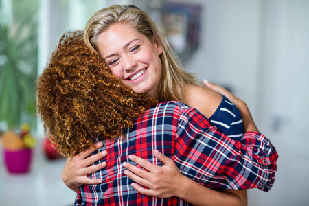 housemate: Happy friends hugging in the kitchen