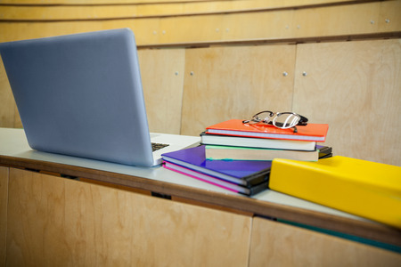 Students books and laptop in an auditorium at the university Stock Photo