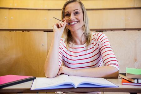 higher intelligence: Happy female student smiling at the university