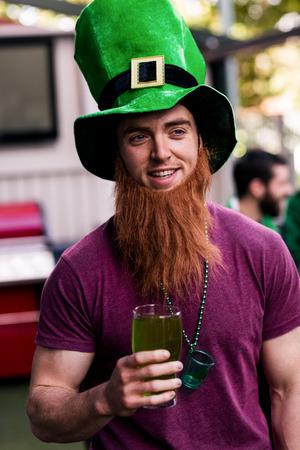 saint patty: Portrait of man celebrating St Patricks day with a green pint