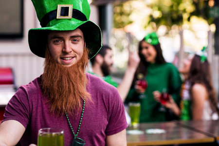 Portrait of man celebrating St Patricks day with a green pint