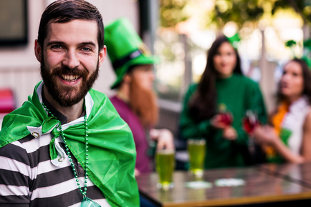 ST: Portrait of man celebrating St Patricks day with friends Stock Photo