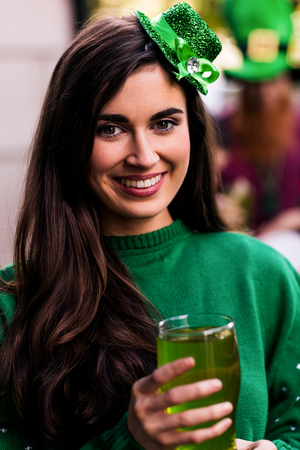 saint patty: Portrait of woman celebrating St Patricks day with a green pint Stock Photo