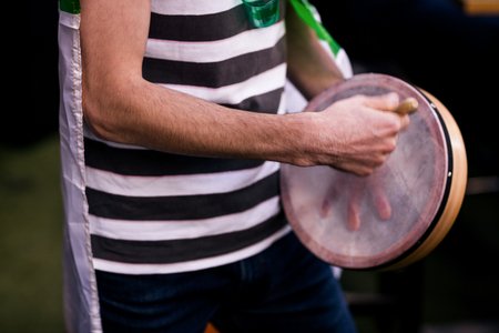 st  patty: Man playing tambourine for St Patricks day Stock Photo