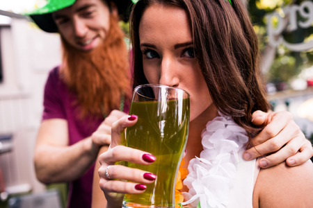 saint patty: Disguised woman holding a green pint for St Patricks day