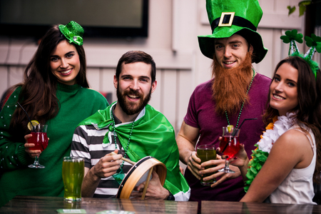 patricks day: Friends celebrating St Patricks day with drinks in a bar