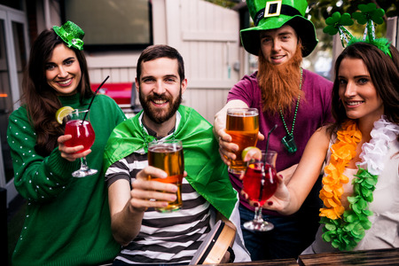 saint patty: Friends celebrating St Patricks day with drinks in a bar